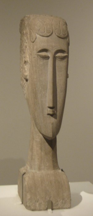 'Woman's_Head',_limestone_sculpture_by_Amedeo_Modigliani,_1912,_Metropolitan_Museum_of_Art